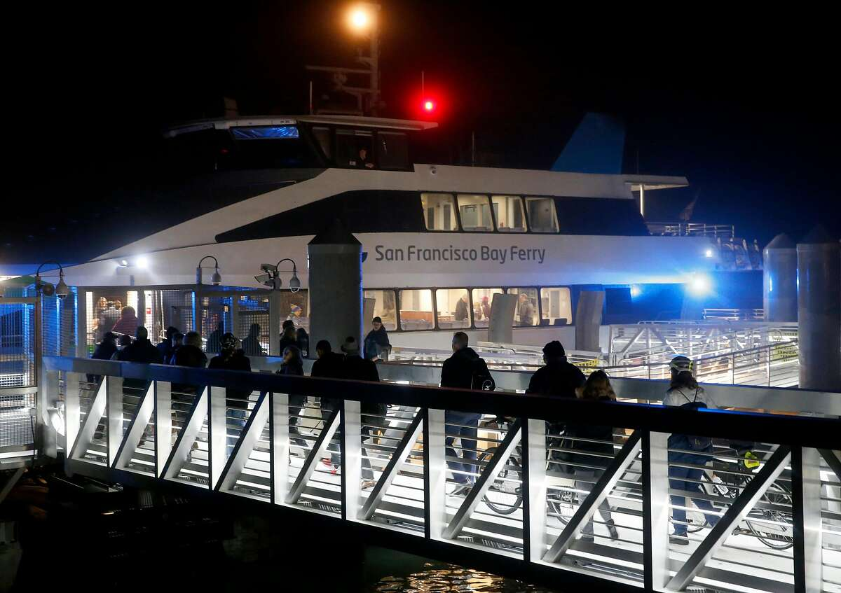 Commuters board the ferryboat Pisces for the inaugural 6:10 a.m. run of ferry service from Richmond to San Francisco in Richmond, Calif. on Thursday, Jan. 10, 2019.