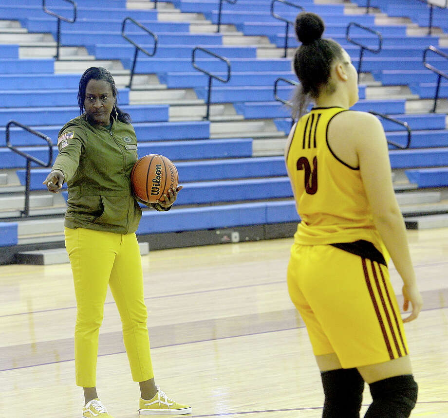 Coach Tammy Walker-Brown offers feedback on play drills as Beaumont United practices Wednesday to prepare for their next district game. The girls are currently undefeated, with a 26-0 run.  Photo taken Wednesday, January 9, 2019 Photo by Kim Brent/The Enterprise Photo: Kim Brent/The Enterprise