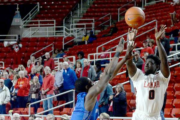 Lamar's Jordan goes for three points as New Orleans' Damion Rosser looks to block during their game Wednesday at the Montagne Center. Photo taken Wednesday, January 9, 2019 Photo by Kim Brent/The Enterprise