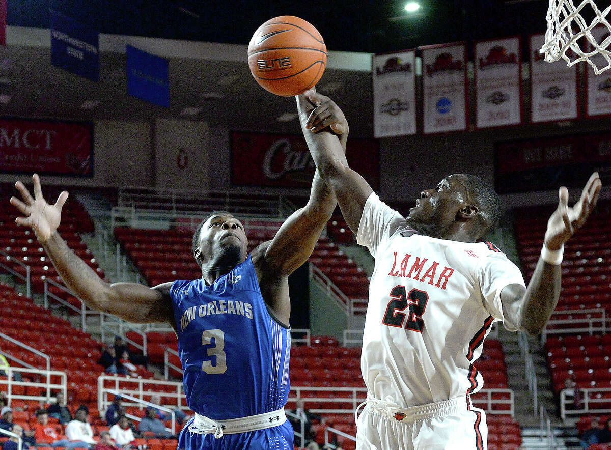 Lamar's Christian Barrett battles with New Orleans' Troy Green for control of the rebound during their game Wednesday at the Montagne Center. Photo taken Wednesday, January 9, 2019 Photo by Kim Brent/The Enterprise