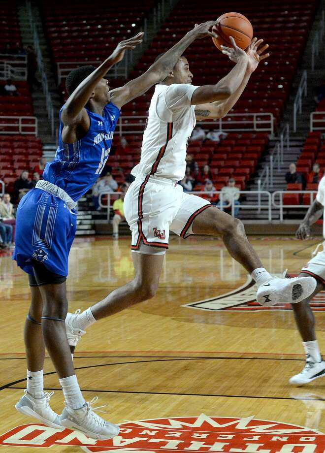 Lamar's T. J. Atwood gets the rebound against New Orleans' Amari Haynes during their game Wednesday at the Montagne Center.  Photo taken Wednesday, January 9, 2019 Photo by Kim Brent/The Enterprise Photo: Kim Brent/The Enterprise