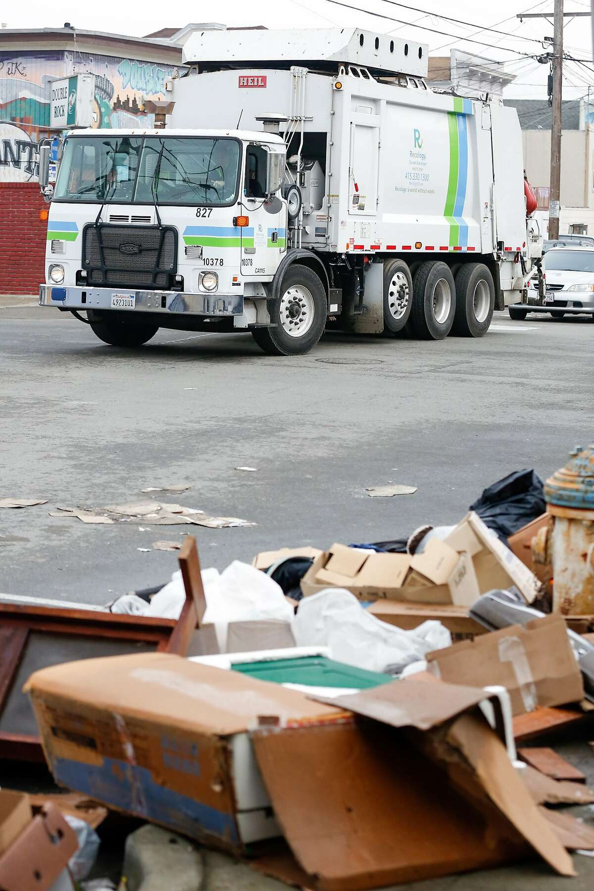 A Recology truck pulls up to a pile of garbage in the Bayview District on Thursday, January 10, 2019 in San Francisco, Calif.