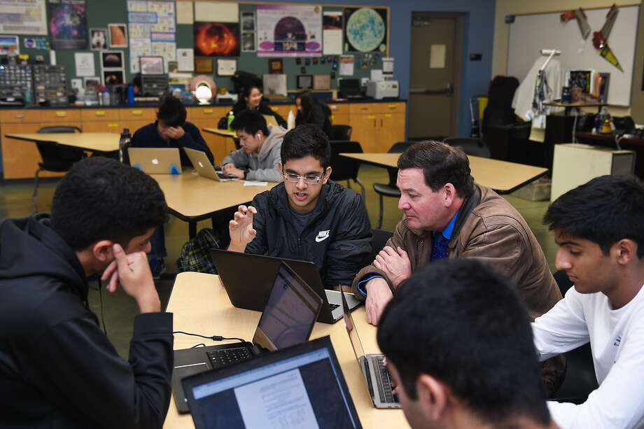 Ayush Alag, 17, from Santa Clara, a senior at Harker School, who is developing a DNA test to help him battle his food allergies, works with his teacher Dr. Eric Nelson at the Harker School in San Jose on Thursday December 6, 2018. Photo: Cody Glenn, Special To The Chronicle