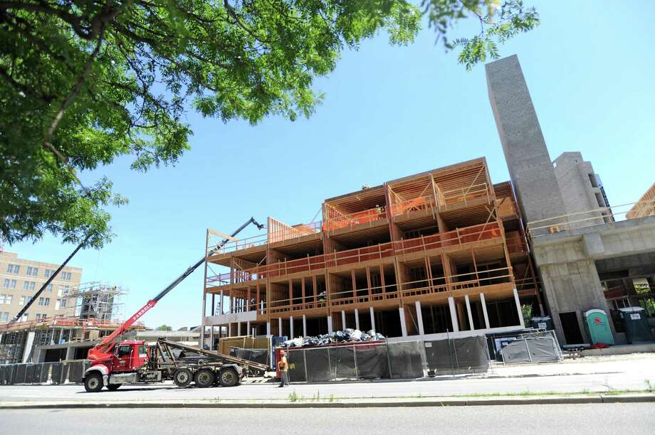 A mixed-use development goes up at Tresser Boulevard and Greyrock Place in June. Board of Representatives members sparred over raising building-permit rates this week. Photo: Michael Cummo / Hearst Connecticut Media / Stamford Advocate