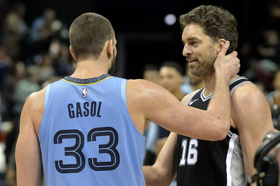 Memphis Grizzlies center Marc Gasol (33) greets his brother San Antonio Spurs center Pau Gasol (16) after an NBA basketball game Wednesday, Jan. 9, 2019, in Memphis, Tenn. (AP Photo/Brandon Dill) Photo: Brandon Dill, Associated Press