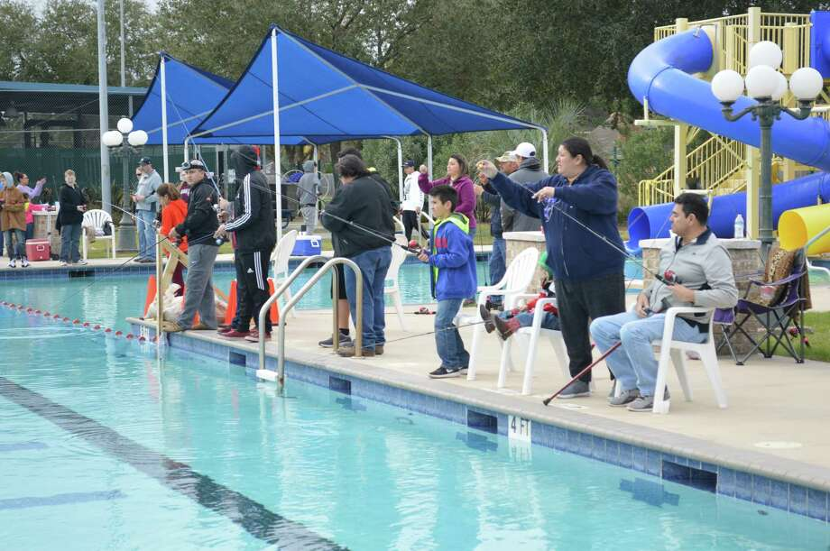 Anglers can see the trout they are trying to catch during the city of Deer Park's Roscoe's Fishing Adventure in the city pool at Dow Park.