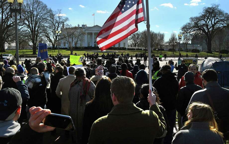 Hundreds of federal workers rallied and listened to speakers at the headquarters of the AFL-CIO before they marched to an area in front of the White House Thursday. Photo: Washington Post Photo By Michael S. Williamson. / The Washington Post