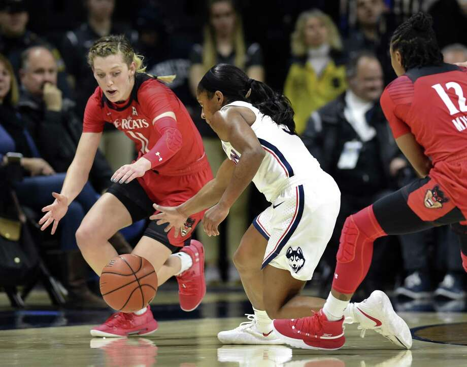 UConn's Crystal Dangerfield (5) steals the ball from Cincinnati's Sam Rodgers (11) Wednesday night's 82-38 win in Storrs. Photo: Stephen Dunn / Associated Press / Copyright 2019 The Associated Press. All rights reserved