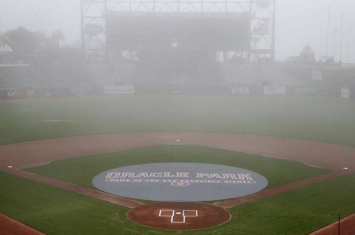 A tarp with the stadium's new name covers the pitcher's mound and part of the infield before the Giants announce the name change to Oracle Park at a news conference in San Francisco, Calif. on Thursday, Jan. 10, 2019, ending a longterm relationship with AT&T.