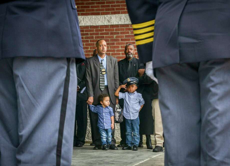 Brandon Sprague, Jr., 5 years old, saluted in March 2016 at funeral services for Prince George's detective Jacai Colson. He was with his father, Brandon, Sr., a retired officer, and his little brother Brian, 2. Photo: Washington Post Photo By Bill O'Leary. / The Washington Post