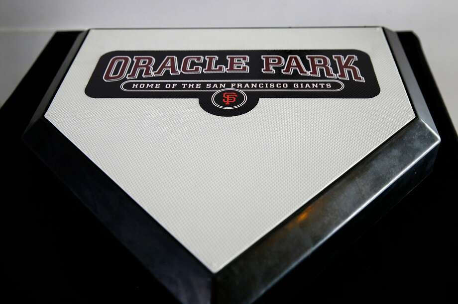 A home plate is emblazoned with the new name of the Giants' ballpark after the team announced at a news conference the name change to Oracle Park in San Francisco, Calif. on Thursday, Jan. 10, 2019, ending a longterm relationship with AT&T. Photo: Paul Chinn / The Chronicle