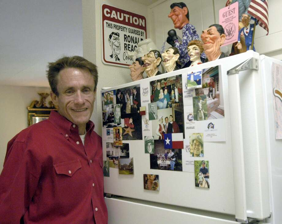 Robin Chiswell poses in front of his refrigerator with more Reagan memorabilia. Chiswell is the person authorities believe sent then-Texas A&M coach Kevin Sumlin a racist letter in 2017. (Photo by Kim Christensen) Photo: Kim Christensen/Special To The Chronicle