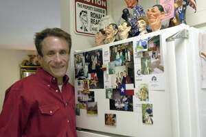 Robin Chiswell poses in front of his refrigerator with more Reagan memorabilia.  (Photo by Kim Christensen)