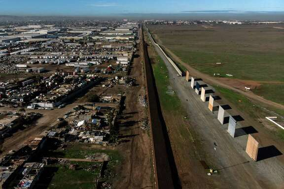 Aerial view of President Donald Trump's border wall prototypes as seen from Tijuana, Mexico, on Monday. A reader tells why Democrats are wrong on the wall.