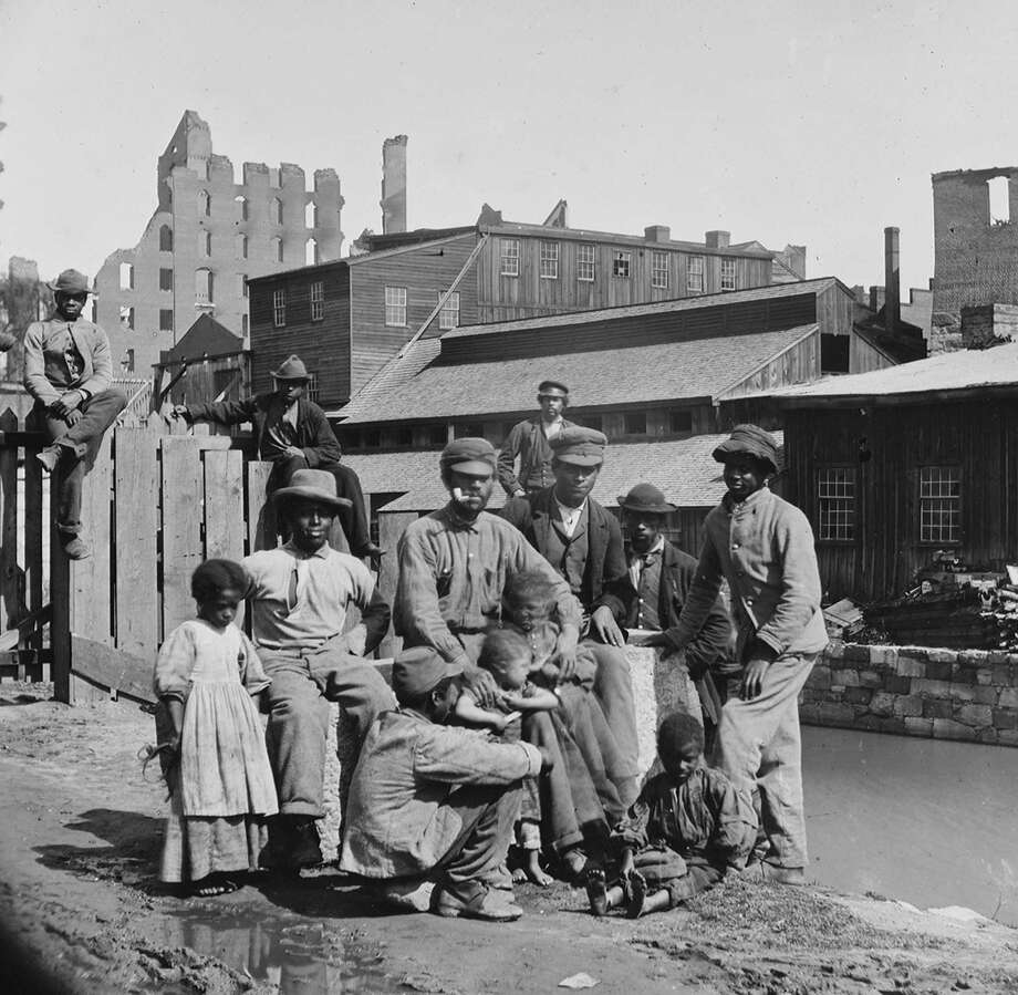 "In this photo provided by the Library of Congress, a group of ""Freedmen"" African Americans pose by a canal in Richmond, Va., during the Civil War in April 1865. A reader disputes that slavery was the issue driving the Civil War. Photo: Alexander Gardner /ASSOCIATED PRESS / AP1865"