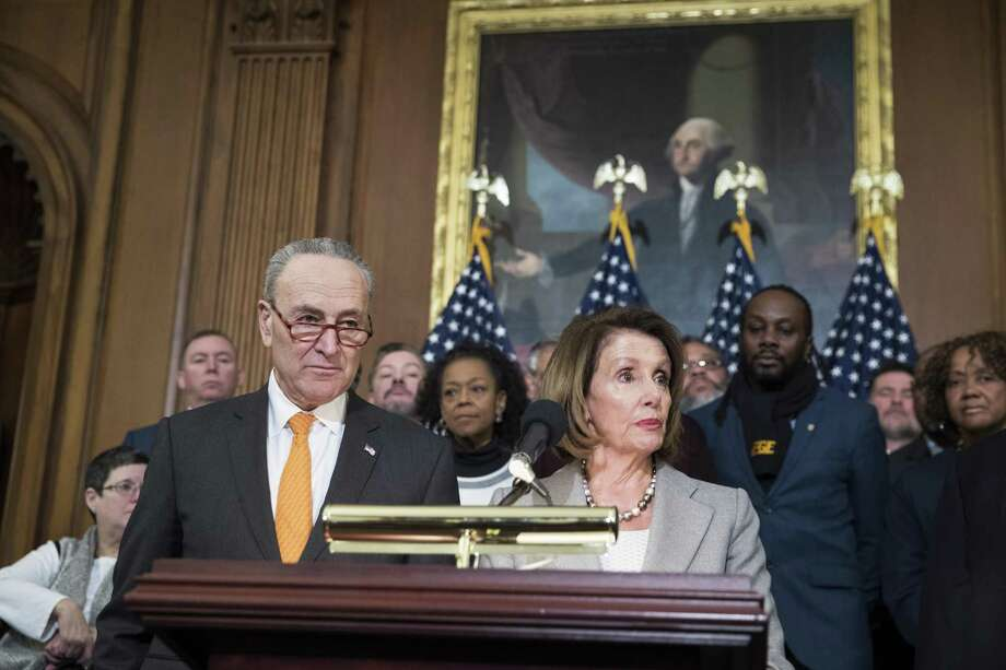 Senate Minority Leader Sen. Chuck Schumer and House Speaker Nancy Pelosi, shown during a news conference with government workers on Wednesday, responded jointly to President Trump's prime-time address on Tuesday — a duel of words that Trump won. Photo: SARAH SILBIGER /NYT / NYTNS