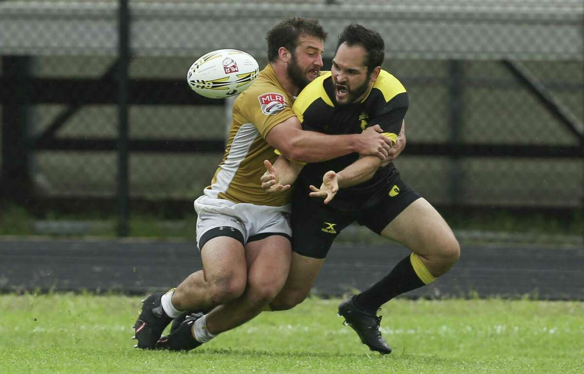Houton SaberCats Dan Paul, right, passes the ball to Alex Elkins, who then scores a try, while New Orleans Eric Howard is attacking him during the second half of the home opener of the Major League Rugby game at Dyer Stadium on Saturday, April 21, 2018, in downtown Houston. The Houston SaberCats lost to the New Orleans Gold 32-26. ( Yi-Chin Lee / Houston Chronicle )