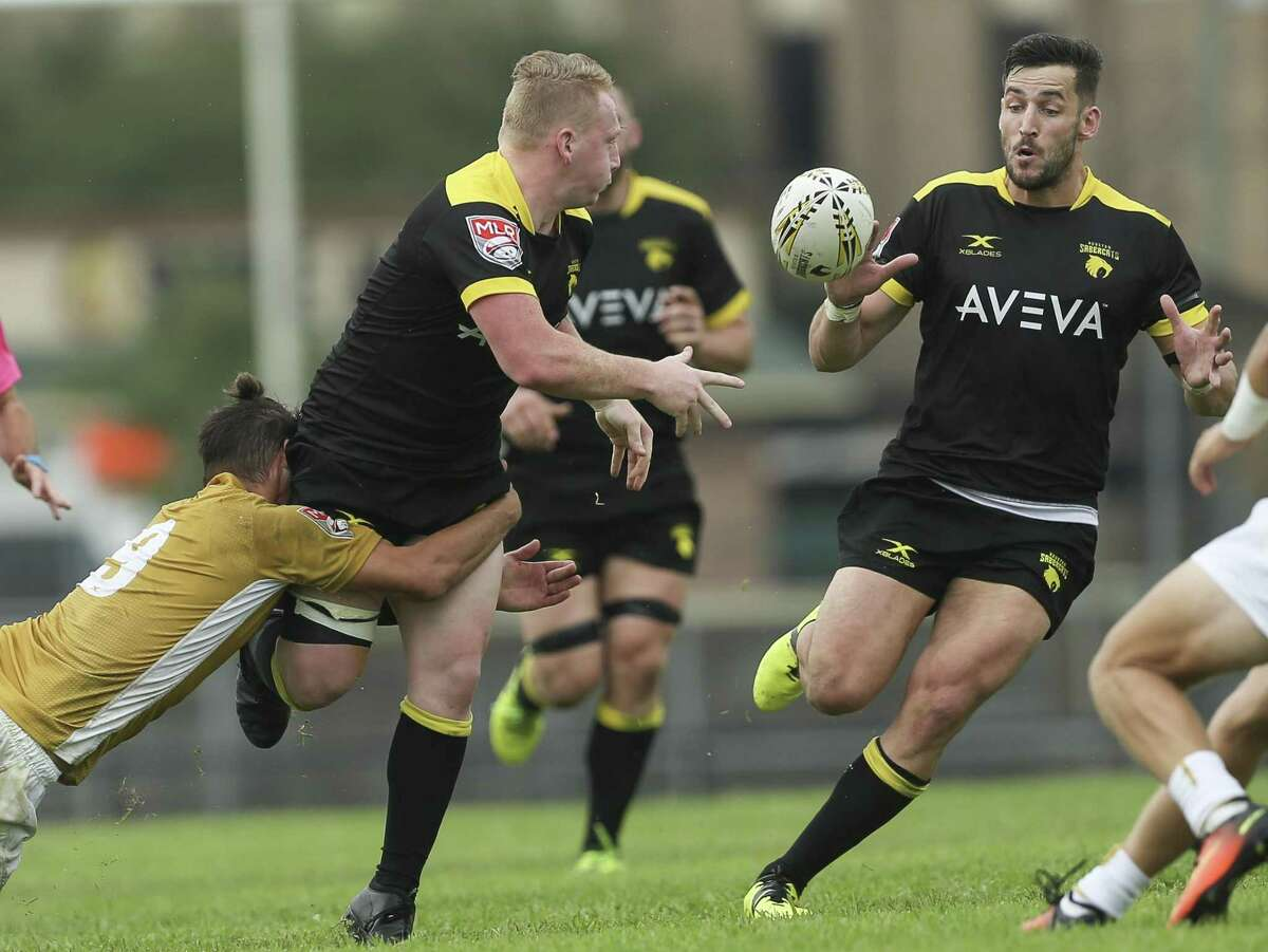 Houston SaberCats Connor Murphy, center, passes the ball to Sam Windsor while being attacked by New Orleans Gold Holden Yungert (9) during the second half of the home opener of the Major League Rugby game at Dyer Stadium on Saturday, April 21, 2018, in downtown Houston. The Houston SaberCats lost to the New Orleans Gold 32-26. ( Yi-Chin Lee / Houston Chronicle )