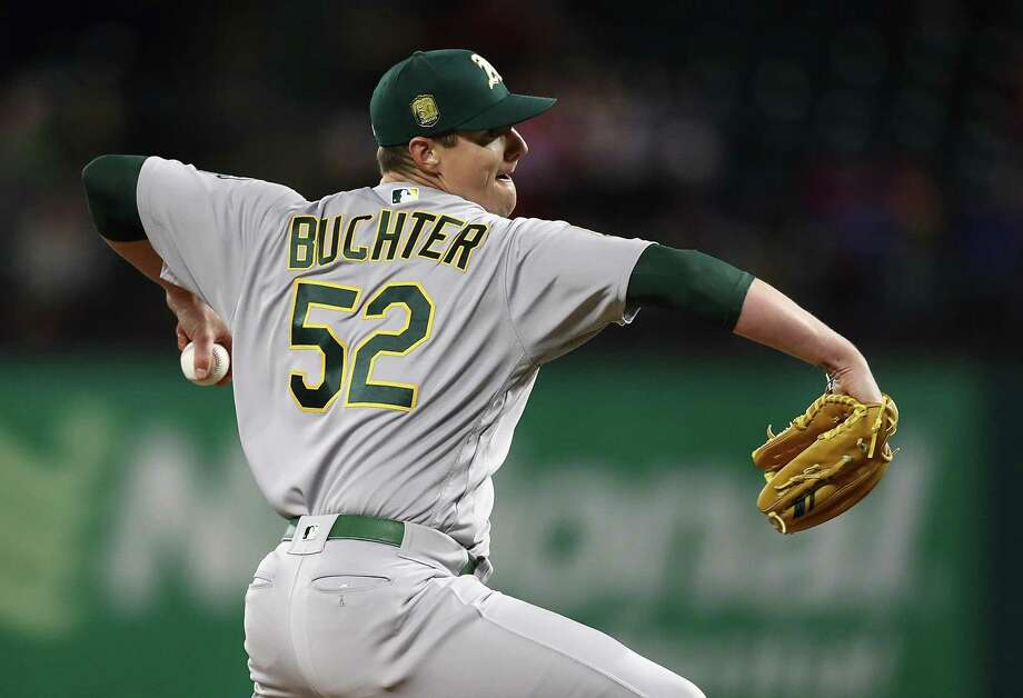 e2534bdfbf5 Ryan Buchter  52 of the Oakland Athletics throws against the Texas Rangers  in the seventh