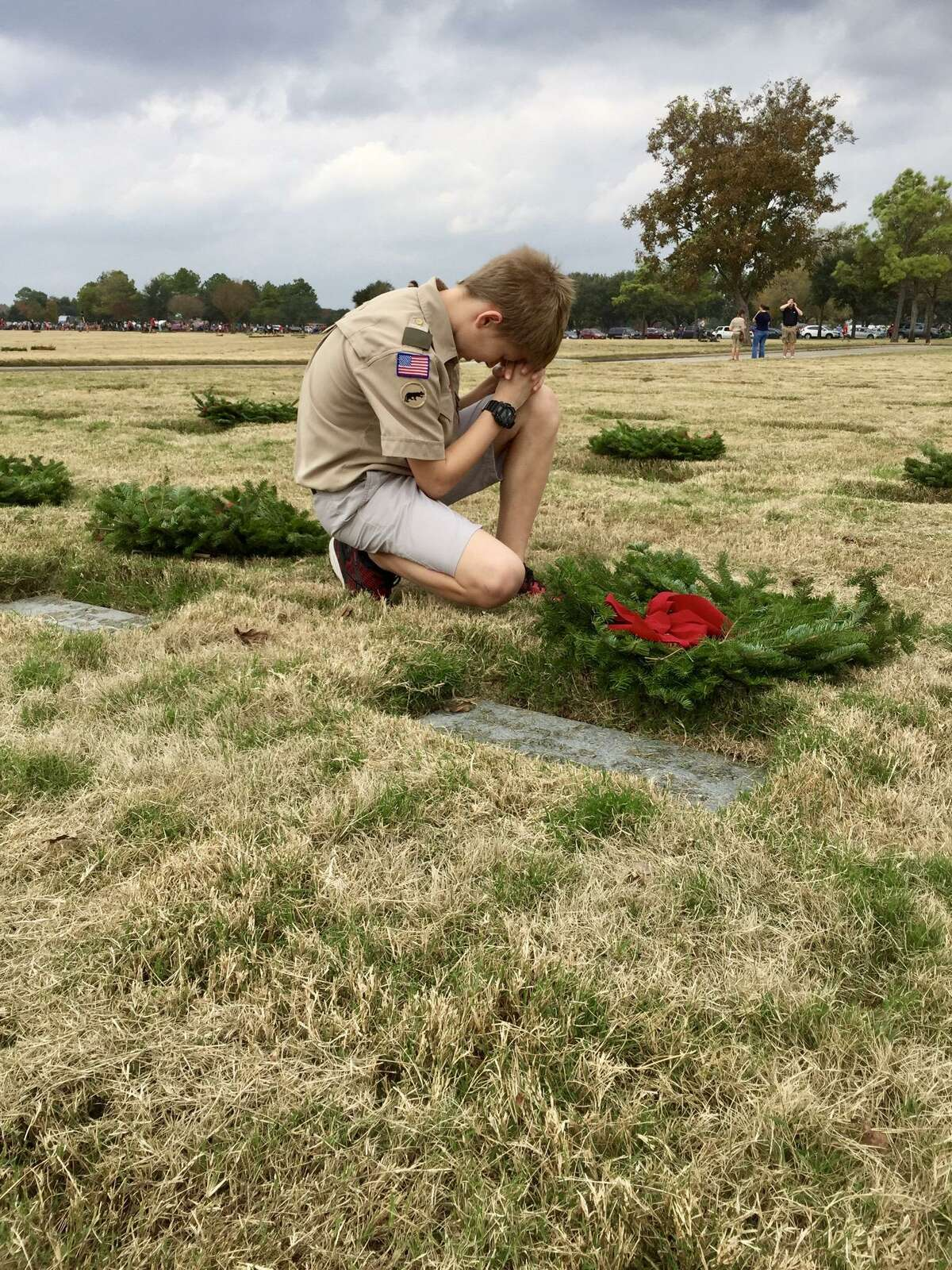 Elijah Knight, who died during a severe storm at a Boy Scouts of America camp in Georgia on June 25, 2018, is shown here in a Dec. 27, 2016 photo at a Wreaths Across America project, placing wreaths at Houston National Cemetery on Veterans Memorial Drive. The Cypress teen's parents have filed a wrongful death lawsuit against the national organization and the Atlanta Area Council of the Boy Scouts of America.