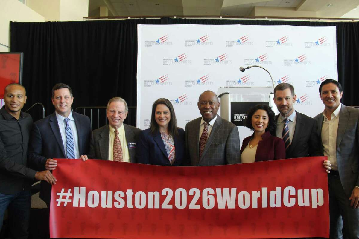Houston's World Cup Bid Committee includes, from left, former Houston Dynamo player Ricardo Clark, bid committee president Chris Canetti, Harris County Houston Sports Authority chairman J. Kent Friedman, HCHSA CEO Janis Burke, Houston Mayor Sylvester Turner, Harris County Judge Lina Hidalgo, chairman John Arnold and former Dynamo player Brian Ching.
