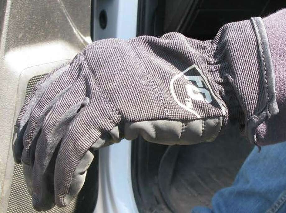 This is the same glove that Justus Booze was wearing when he was pulled into the chipper. The Occupational Safety and Health Administration bought the same gloves he used and determined the open cuff was a danger because it could catch on brush and debris. (Courtesy of OSHA)