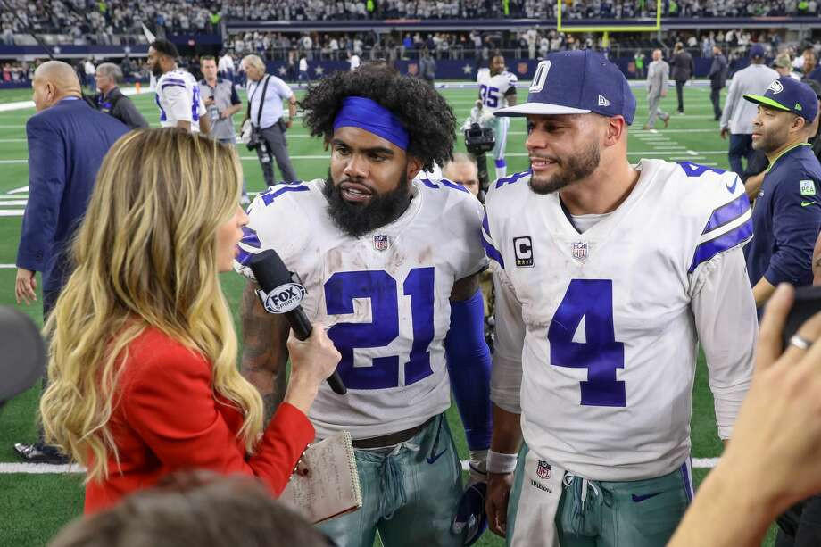 ARLINGTON, TX - JANUARY 05: Dallas Cowboys quarterback Dak Prescott (4) and running back Ezekiel Elliott (21) are interviewed by Fox reporter Erin Andrews after the NFC wildcard playoff game between the Seattle Seahawks and Dallas Cowboys on January 5, 2019 at AT&T Stadium in Arlington, TX. (Photo by Andrew Dieb/Icon Sportswire via Getty Images) Photo: Icon Sportswire/Icon Sportswire Via Getty Images