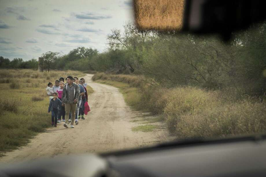 Central American families turn themselves in to Border Patrol agents near McAllen last month. In the fifth week of a partial government shutdown over President Donald Trump's proposed border wall, Trump offered a deal to Democrats to include some humanitarian assistance and 3-year protections for immigrants with DACA and TPS in exchange for $5.7 billion for his wall. Photo: Marie D. De Jesús, Houston Chronicle / Staff Photographer / © 2018 Houston Chronicle