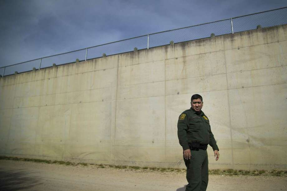 Acting Rio Grande Valley Border Patrol Chief Raul Ortiz walks past a fortified concrete levy near McAllen, which, he said, coupled with more technology and manpower, could help agents arrest more migrants by funneling them into smaller areas. But he said it would do nothing to stop the influx of families. Photo: Marie D. De Jesús, Houston Chronicle / Staff Photographer / © 2018 Houston Chronicle