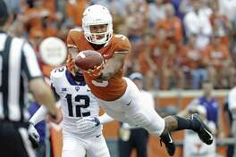 Texas wide receiver Collin Johnson, who had 68 catches for 985 yards and seven TDs this season, mulled the NFL draft before deciding to return for his senior year.