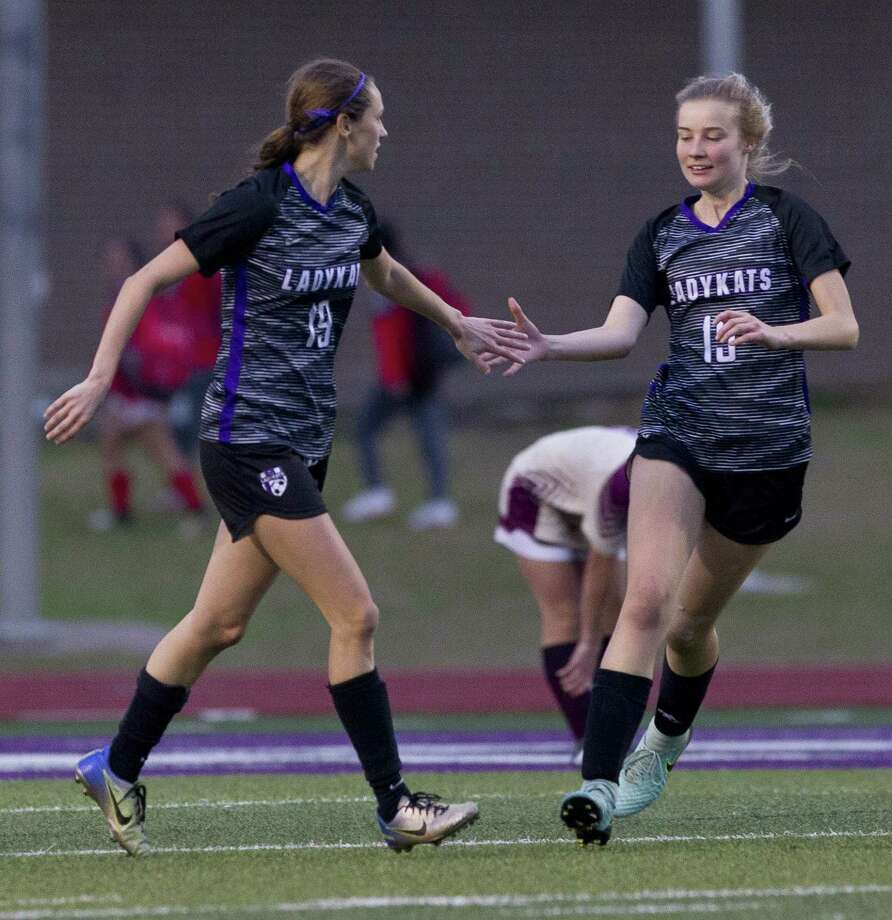 Willis' Kaitlyn Drewniok, left, gets a high-five from teammate Rachel Inman after scoring a goal in the second period of a match during the Willis Kat Cup soccer tournament at Berton A. Yates Stadium, Thursday, Jan. 10, 2019, in Willis. Photo: Jason Fochtman, Houston Chronicle / Staff Photographer / © 2019 Houston Chronicle