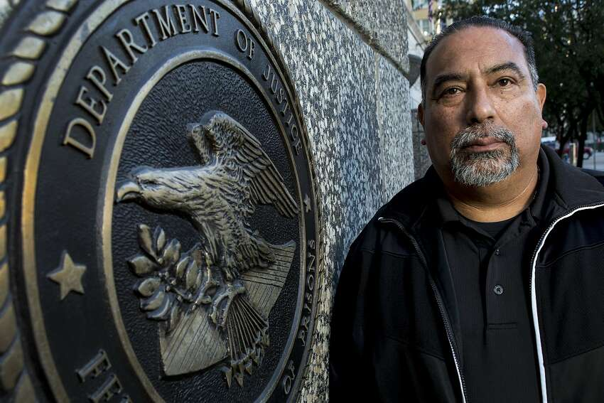 Federal Correctional Counselor Rey Osorio, president of American Federation of Government Employees Local 1030, is one of the many federal employees still working, but not being paid, during the government shutdown on Wednesday, Jan. 9, 2019, in Houston. Osorio works in the Federal Detention Center in Downtown Houston.