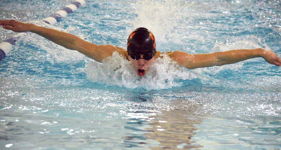 Edwardsville's Logan Mills swims in the 100-yard butterfly during Thursday's triangular meet against Chatham Glenwood and O'Fallon at Chuck Fruit Aquatic Center. Photo: Scott Marion/Intelligencer