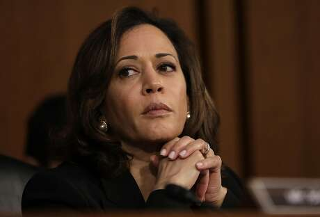 Harris listens as Supreme Court nominee Brett Kavanaugh appears before the Senate Judiciary Committee in September before he was confirmed. Harris is known for tussling with President Trump's nominees during committee hearings. Photo: Drew Angerer / Getty Images 2018
