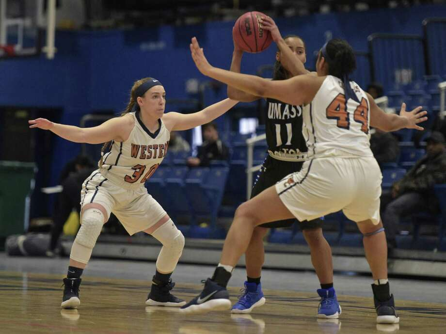 Westconn's Jancy Sherwood, left, shown in a 2018 game, scored 16 in a 103-66 loss to UMass-Dartmouth on Thursday to reach 1,006 career points. Photo: H John Voorhees III / Hearst Connecticut Media / The News-Times