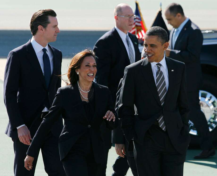 Harris walks with Lt. Gov. Gavin Newsom (left) and President Barack Obama after Obama's arrival in S.F. in February 2012. Photo: Paul Chinn / The Chronicle 2012