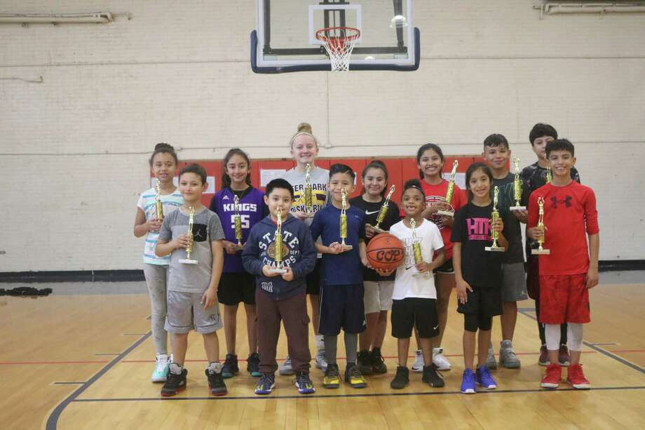 Many of last weekend's Super Swish trophy winners pose with their newly-won trophies, following competition in three age divisions at PAL Gym. Photo: Robert Avery