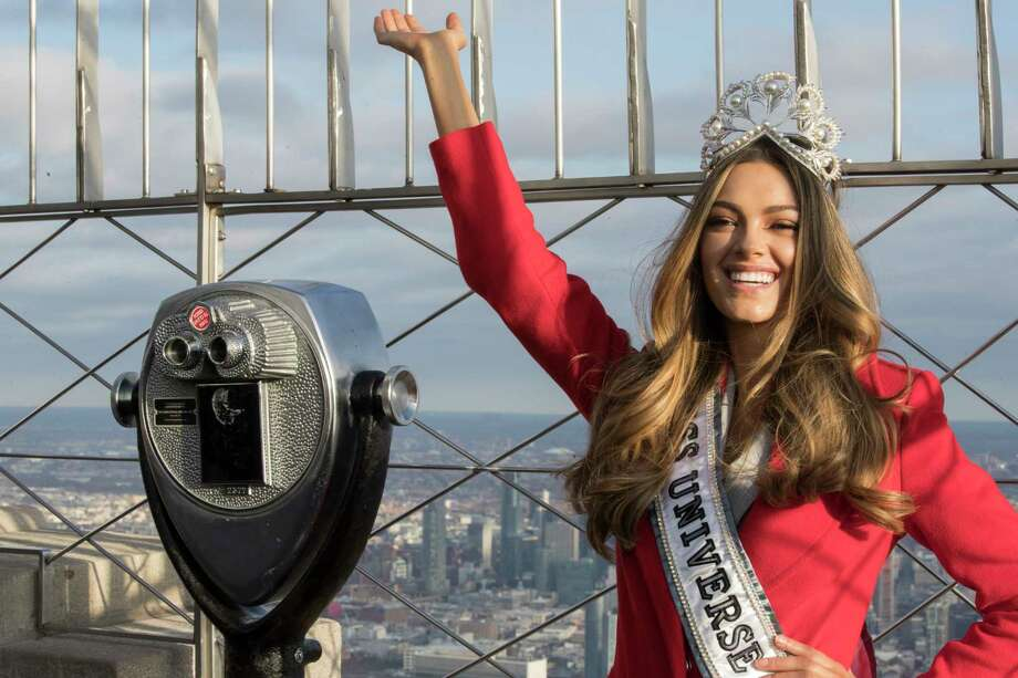 FILE - In this Tuesday, Nov. 28, 2017 file photo, Miss Universe 2017 Demi-Leigh Nel-Peters, of South Africa, poses for photographers on the 86th Floor Observation Deck of the Empire State Building in New York. Former Denver Broncos and University of Florida quarterback Tim Tebow is engaged. The Heisman Trophy winner announced his engagement on Instagram Thursday, Jan. 10, 2019 to Demi-Leigh Nel-Peters, a South Africa native and the 2017 Miss Universe. (AP Photo/Mary Altaffer, File) Photo: Mary Altaffer / Copyright 2017 The Associated Press. All rights reserved.