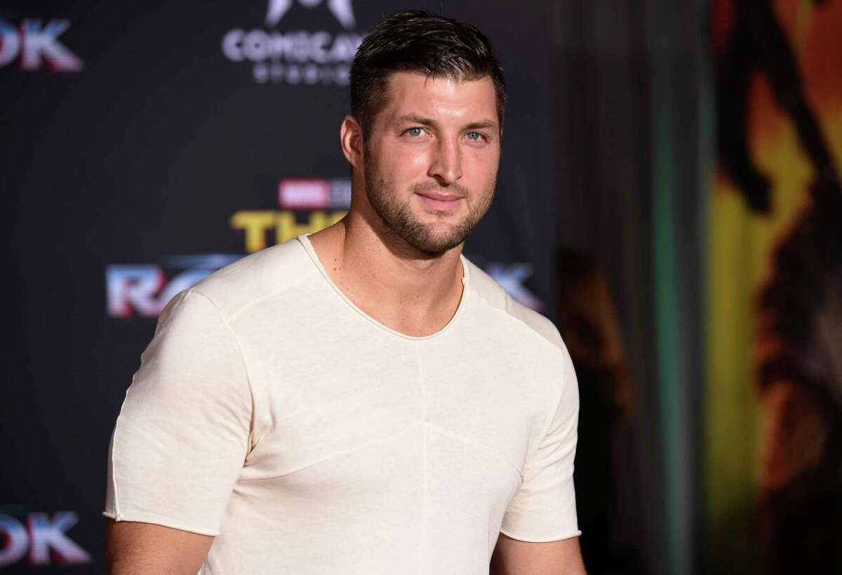FILE - In this Tuesday, Oct. 10, 2017 file photo, Tim Tebow arrives at the world premiere of