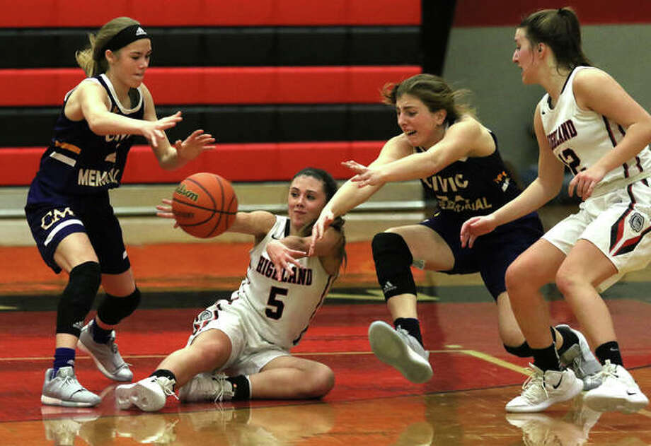 Highland's Ellie Brown (5) tries to find a teammate after going to the floor while defended by CM's Maura Niemeier (left) and Jackie Woelfel (second right) with the Bulldogs' Mae Riffel watching the play. The pass was stolen by Kourtland Tyus with four seconds left in the game to secure CM's 43-41 victory Thursday night in Highland. Photo: Greg Shashack / The Telegraph