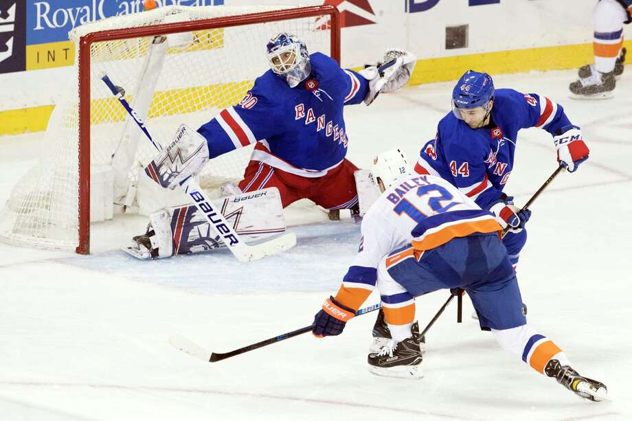 New York Islanders right wing Josh Bailey (12) scores the winning goal past New York Rangers goaltender Henrik Lundqvist (30) during the third period of an NHL hockey game, Thursday, Jan. 10, 2019, at Madison Square Garden in New York. (AP Photo/Mary Altaffer) Photo: Mary Altaffer / Copyright 2019 The Associated Press. All rights reserved.