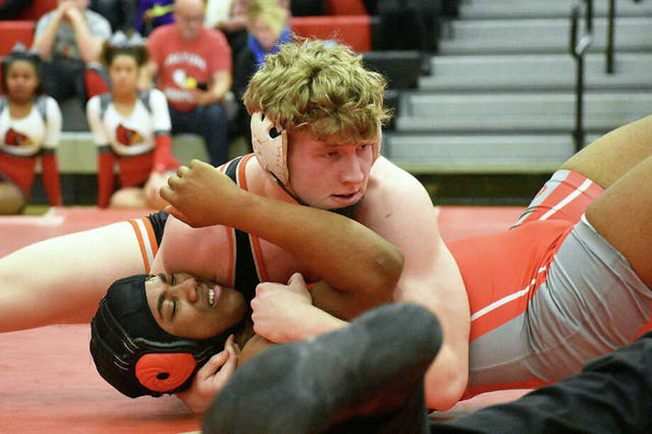 Edwardsville's Sam Martin earns a pin at 195 pounds during a match against Alton on Thursday in Alton. Photo: Matt Kamp/Intelligencer