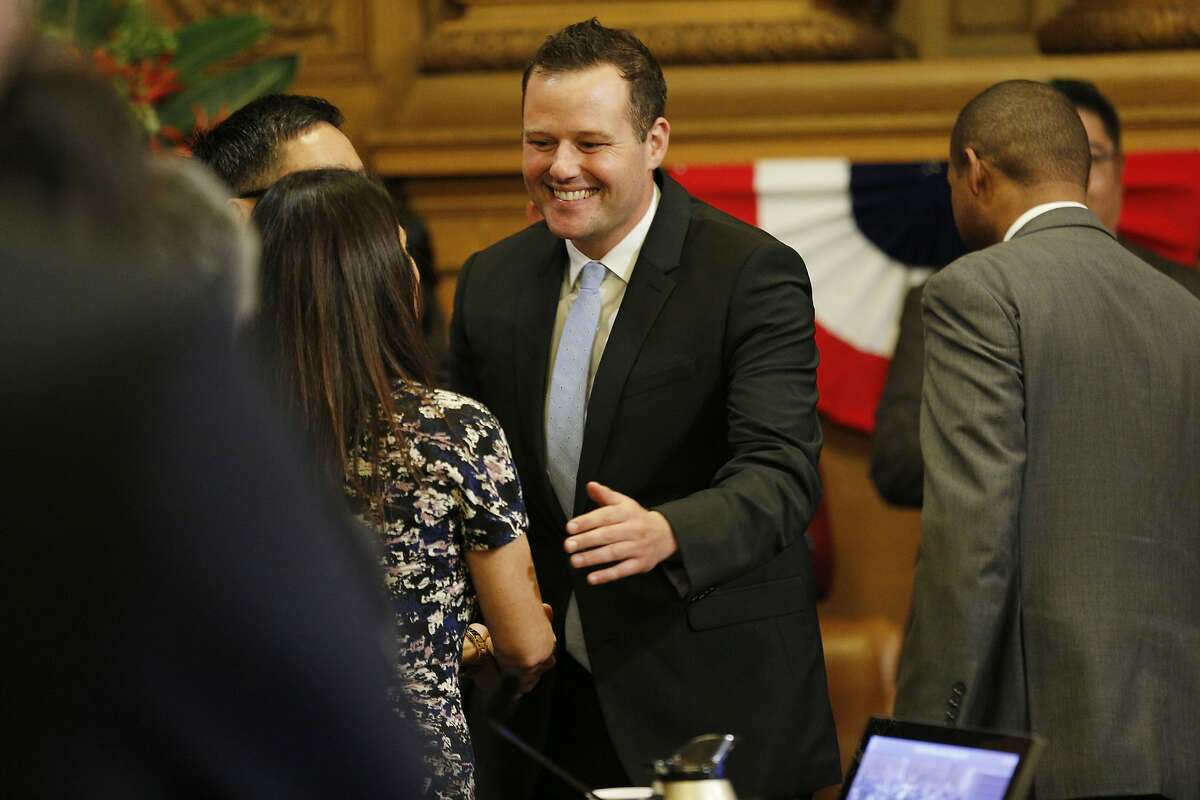 District 6 supervisor Matt Haney (center) and District 2 supervisor Catherine Stefani greet after being sworn in to the Board of Supervisors at City Hall on Tuesday, Jan. 8, 2019, in San Francisco, Calif.