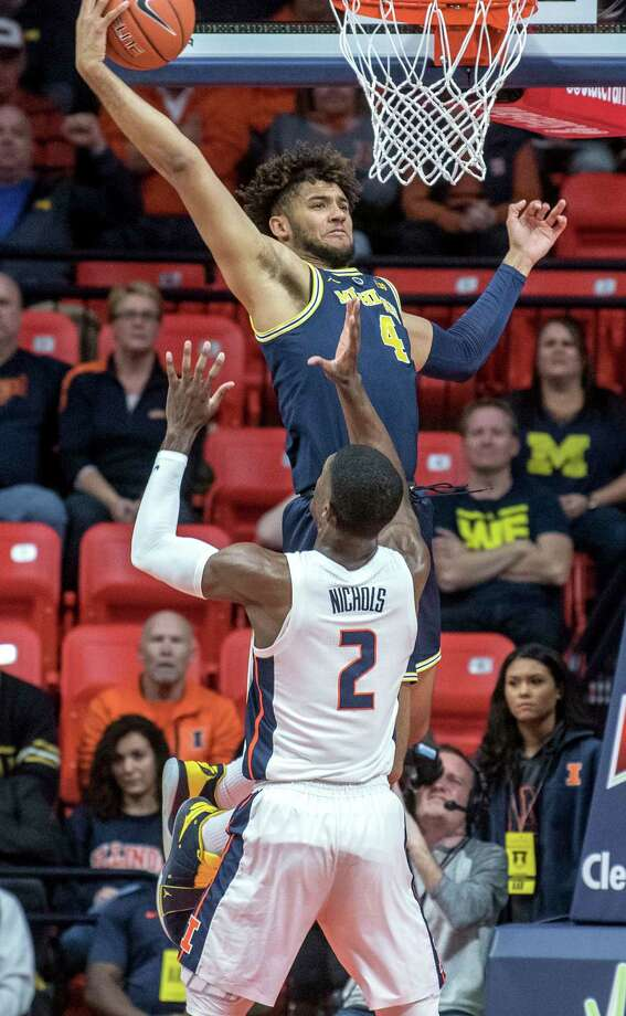 Michigan forward Isaiah Livers (4) goes up for a rebound over Illinois forward Kipper Nichols (2) during the first half of an NCAA college basketball game in Champaign, Ill., Wednesday, Jan. 10, 2019. (AP Photo/Rick Danzl) Photo: Rick Danzl / Copyright 2019 The Associated Press. All rights reserved.