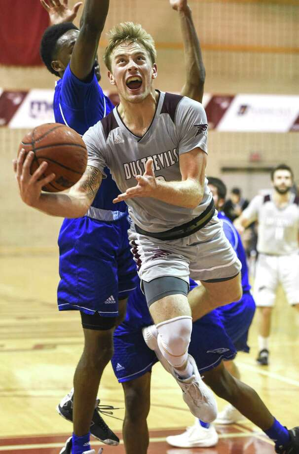 Brent Finn, pictured, and Xabier Gomez each scored 20 for TAMIU, but the Dustdevils lost 89-69 at No. 3 St. Edward's despite their best shooting performance of the season after finishing on the wrong end of the turnover battle at 24-8. Photo: Danny Zaragoza /Laredo Morning Times File