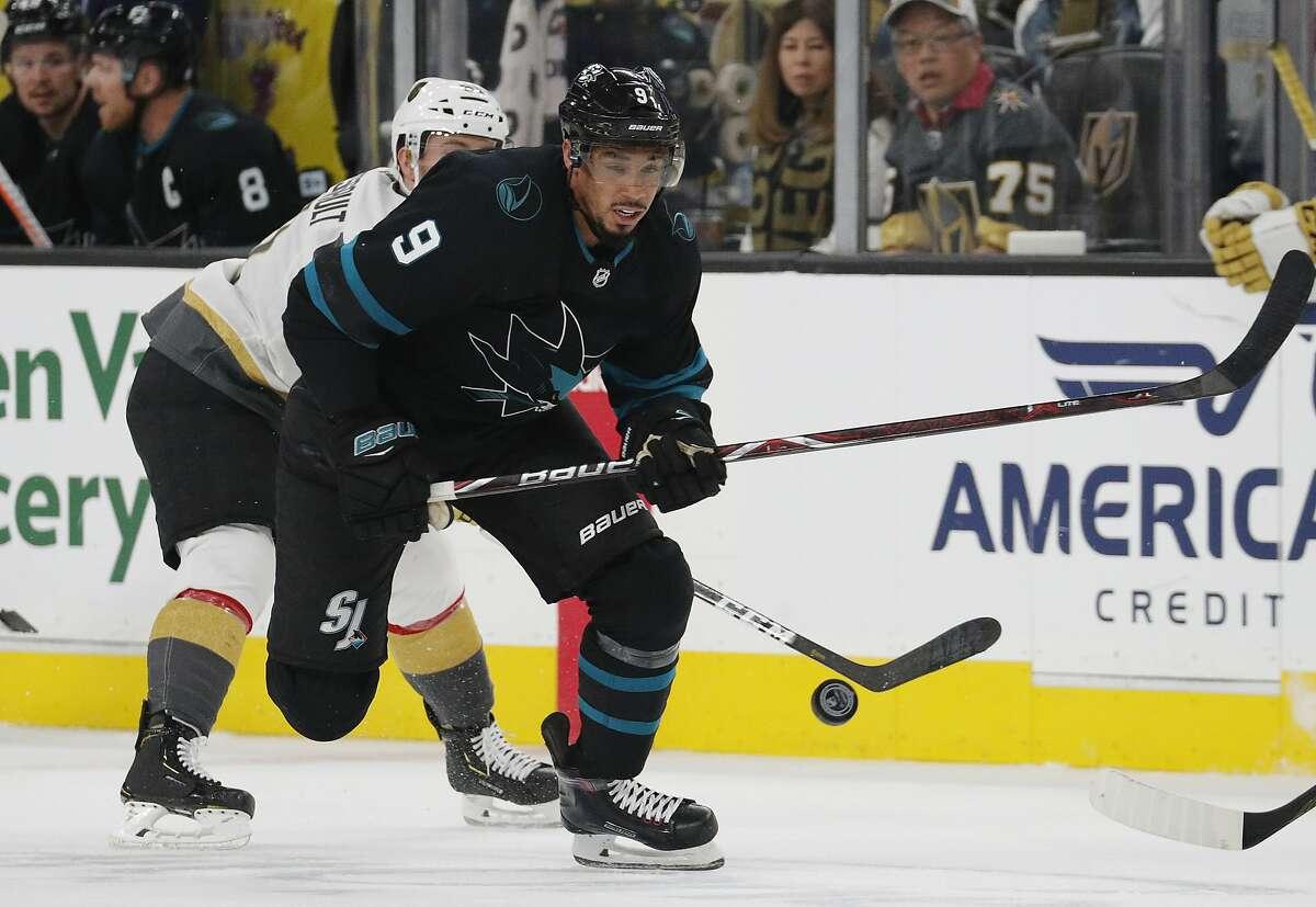 San Jose Sharks left wing Evander Kane (9) skates around Vegas Golden Knights center Jonathan Marchessault during the first period of an NHL hockey game Thursday, Jan. 10, 2019, in Las Vegas. (AP Photo/John Locher)