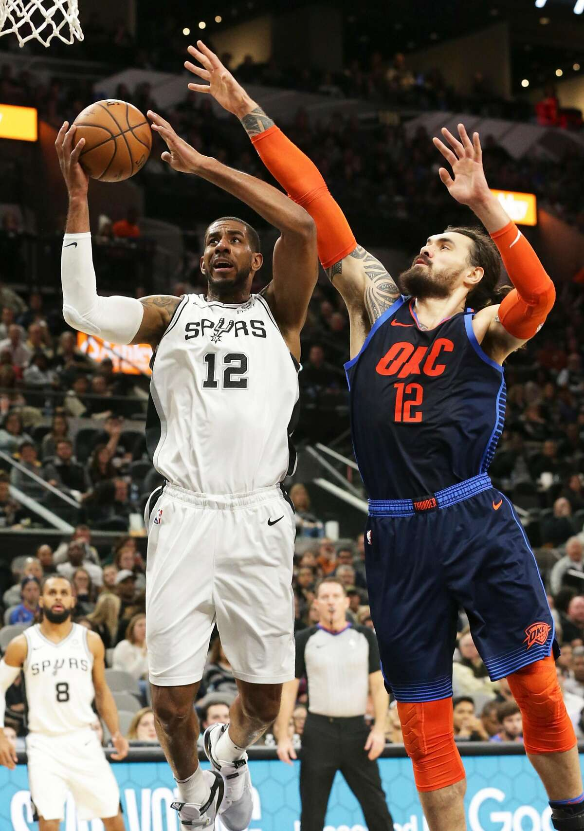 LaMarcus Aldridge lays a shot in over Steven Adams as the Spurs host Oklahoma at the AT&T Center on January 10, 2019.