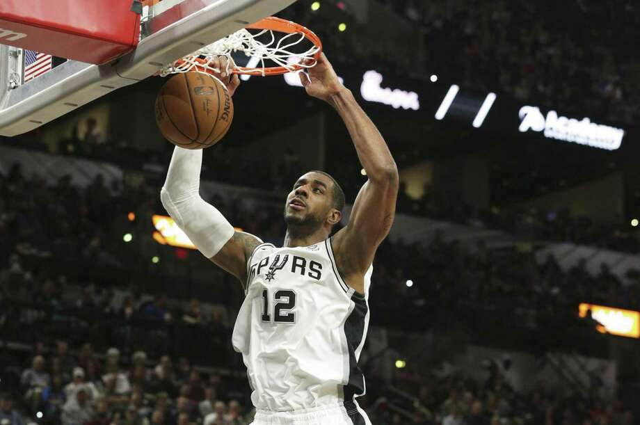 LaMarcus Aldridge jams a shot down as the Spurs host Oklahoma at the AT&T Center on January 10, 2019. Photo: Tom Reel, Staff / Staff Photographer / 2018 SAN ANTONIO EXPRESS-NEWS