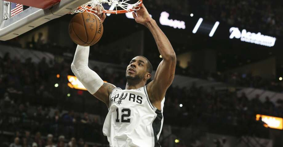 LaMarcus Aldridge jams a shot down as the Spurs host Oklahoma at the AT&T Center on January 10, 2019. Photo: Tom Reel/Staff Photographer