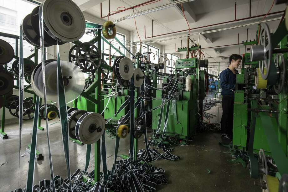 Polyvinyl chloride is fed into machines to make artificial Christmas tree branches at a factory in Yiwu, China, on Oct. 25, 2018. Photo: Bloomberg Photo By Qilai Shen. / © 2018 Bloomberg Finance LP